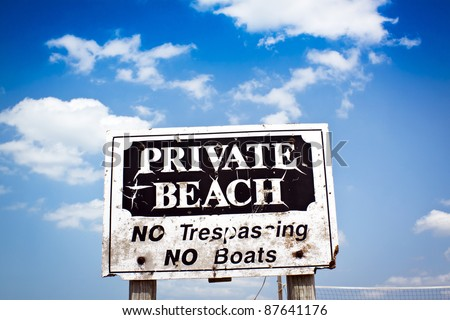 Sign Private beach with blue cloudy sky