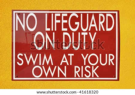 "sign reading ""no lifeguard on duty"""