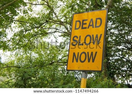 """Sign saying """"DEAD SLOW NOW"""""""