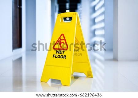 Sign showing warning of  wet floor on wet  floor  #662196436