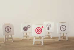 Sign stand with an arrow in the target. Stand out from the crowd and think different creative idea concepts. Tactics of advertising targeting. advertise campaigns. Goal Achievement and Purposefulness.