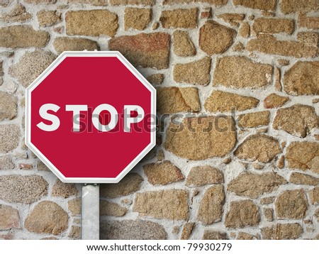 sign stop on stone wall