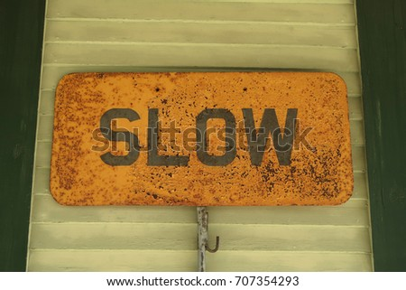 Sign that says, Slow.                                #707354293