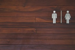 Sign toilet on wood background. Male and female.