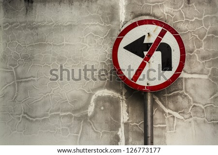 """Sign Warning """"Don't turn Left"""" Sign Warning at the Wall end of a road."""