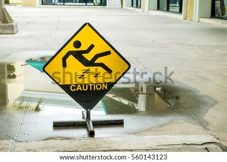 Sign warning of caution wet floor. #560143123