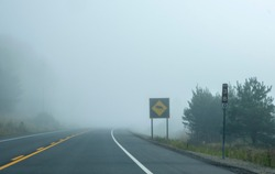 Sign Warning of Moose by the Side of Highway 60 in Algonquin Provincial Park in Early Morning Fog