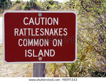 Sign warns of rattlesnakes