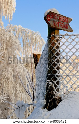 Sign with directions in winter, Bisrtiški Vintgar, Slovenia