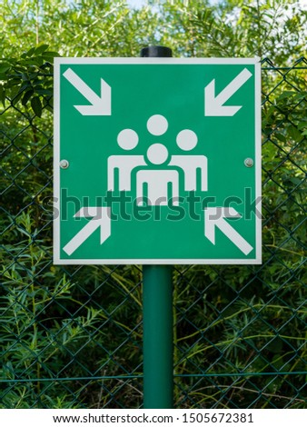 Sign with pictogram symbolizing an assembly station for people in case of an emergency or catastrophe. #1505672381