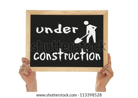 sign with the words under construction - stock photo