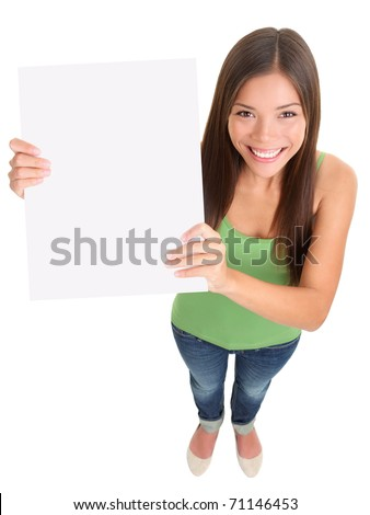 Sign woman smiling. Top view of multi-ethnic girl showing blank empty sign board with copy space for text message. Mixed-race Asian Caucasian female model cut out in full length on white background.