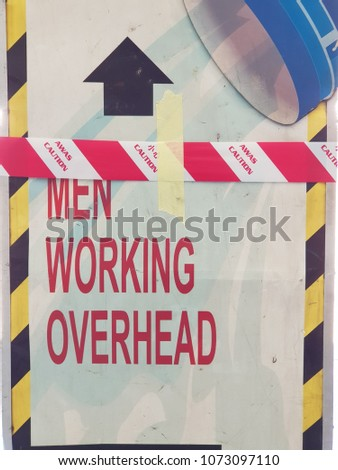 Signage men working overhead with awas (translated as caution) stripe tape Zdjęcia stock ©