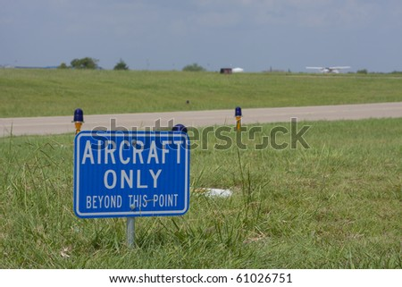 signage on airport runway - stock photo