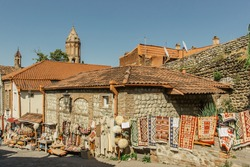 Signagi,tiny town on hill,Georgia,Kakheti region.City of love.Popular tourist destination in wine area.Picturesque landscape,pastel houses and narrow,cobblestone streets.Local market with souvenirs