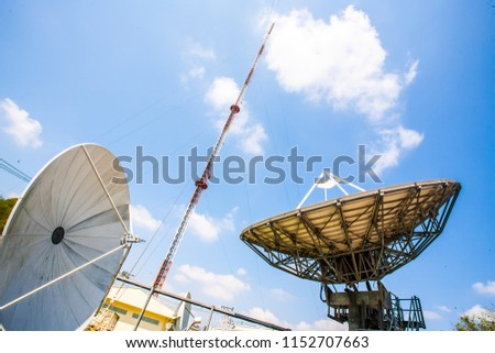 Signal Tower and Sky satellite dish are large and the clouds are white as a backdrop, high telecommunication signal, wireless access equipment, remote signaling, high steel antenna.