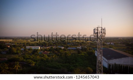 Signal Tower in city wth sunset