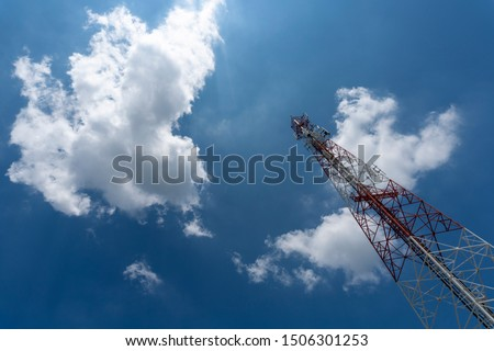 Signal tower or Mobile phone tower with dayligth sky and white cloud. Telecommunication tower Antenna.Modern communication concept by using 5 g internet