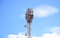 Signal transmitter tower with sky background. Transmitter antenna or tower