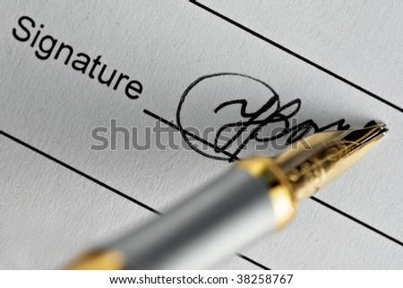 signature and pen close up