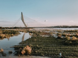 Signature Bridge is a cantilever spar cable-stayed bridge which spans the Yamuna river at Wazirabad section, connecting Wazirabad to East Delhi.
