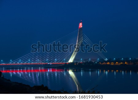 Signature bridge is the tallest structure in Delhi and is double the height of Qutb Minar with its 154-metre hight Lighting on the signature  bridge & Reflecting in the Yamuna river new Delhi India.
