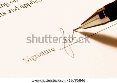 Signature. Close-up of a pen.