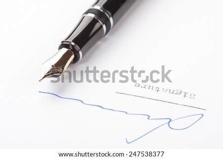 Signature on white paper with old fountain pen