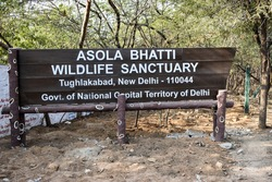 Signboard of Asola Bhatti Wildlife Sanctuary. This protected area contains one of the last surviving remnants of Delhi Ridge hill range and itssemi-aridforest habitat and its dependent wildlife