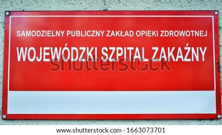 Signboard on the building: Independent public health care - Provincial Infectious Hospital / Samodzielny Publiczny Zaklad Opieki Zdrowotnej - Wojewodzki Szpital Zakazny Zdjęcia stock ©