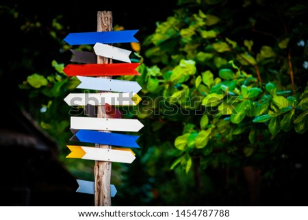signboards with arrows on a wooden pole #1454787788