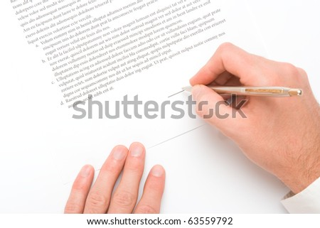 Signing a contract - hand with pen closeup