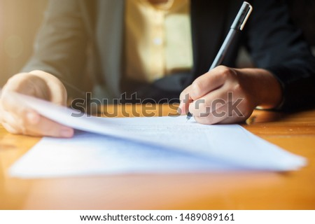 Signing a contract, legal agreement, or business agreement. #1489089161