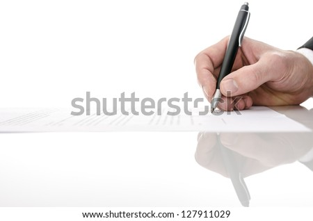 Signing a contract on a white table. With copy space. - stock photo