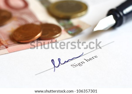 signing a deal with money