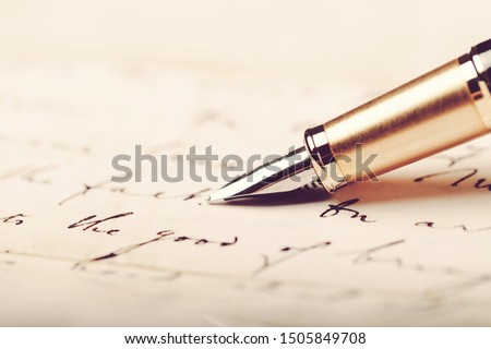 Signing a signature with a fountain pen Photo stock ©