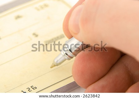 signing check close up with shallow depth of field