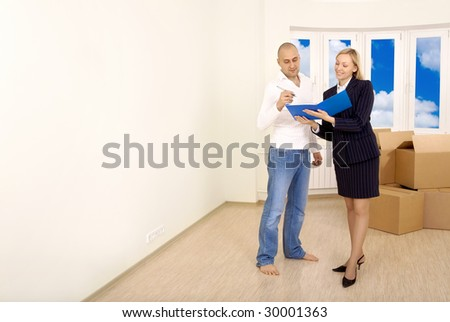 Signing of documents by the owner in an interior of new apartment