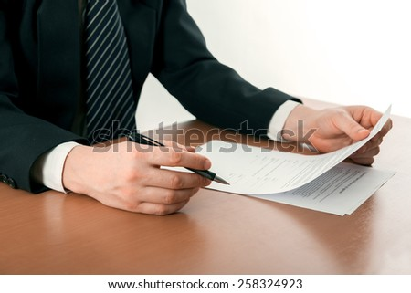 Signing papers. Lawyer, realtor, businessman sign documents.