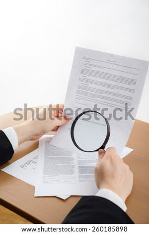 Signing papers. Lawyer, realtor, businessman sign documents, looking through the magnifying glass, search information.