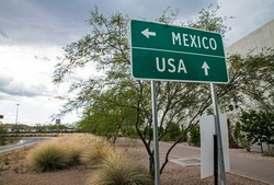 Signpost at the US-Mexican border