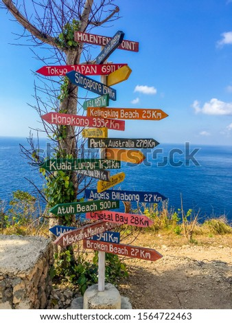 Signpost With Directions To Travel Destinations in Bali