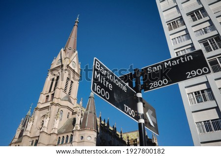 Signpost with street names at intersection of Bartolome Mitre and San Martín streets in Mar del Plata, Argentina. Cathedral Church called Basilica Catedral de los Santos Pedro y Cecilia on background. Zdjęcia stock ©