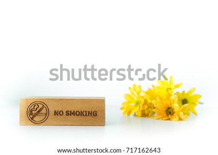 Signs and symbol no smoking and yellow flower on white background, isolated, copy space. #717162643