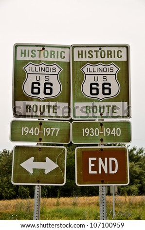 Signs denoting parts of Illinois Route 66 from different years