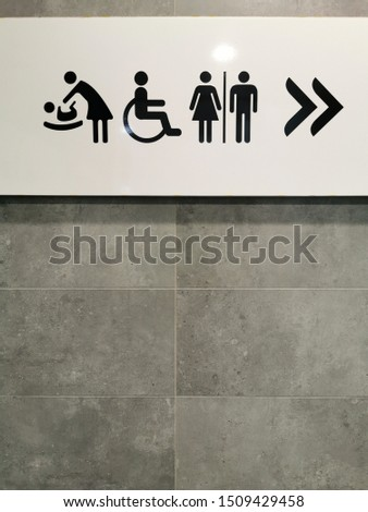 Signs for restoroom toilet or maternity or baby room hanging on the wall #1509429458