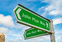 Signs for the John Muir Way walking trail.