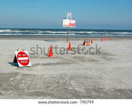 Signs for traffic flow on a beach