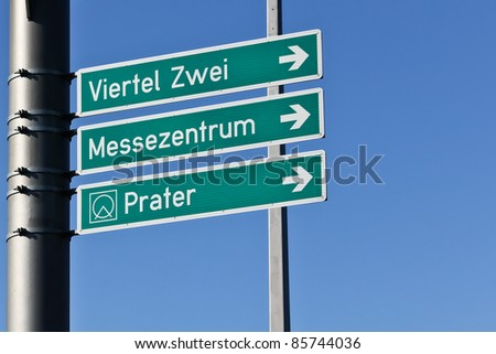 Signs for traffic on a large public street in Vienna leading to famous destinations
