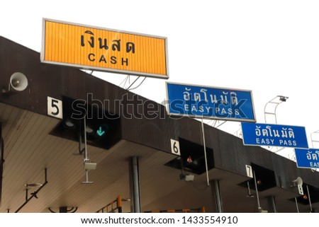 Signs of Expressway tollgate, Gate toll payment on expressway, Fee to use the express route, Tollway gate in Thailand.